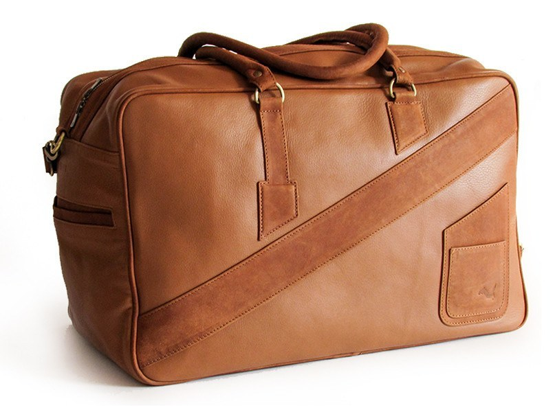A perspective view of KANZEK's leather duffle bag for men in brown with full grain calf leather