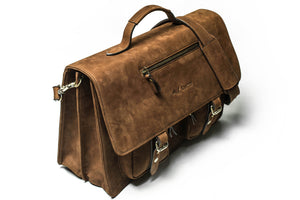 A perspective view of KANZEK's laptop leather satchel or messenger bag for men in vintage brown with full grain calf leather