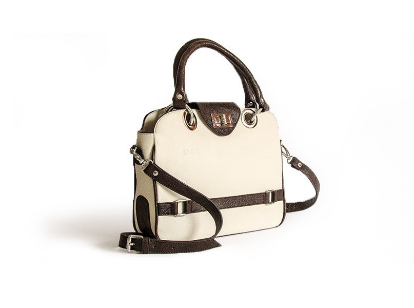 The Little Embrace Flapbag in its white and dark brown color is a highly design and compact handbag for women.