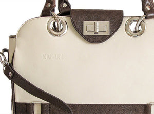The Little Embrace Flapbag in its White and Dark Brown version has a crackled dark brown leather with a unique patina.