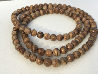 The Magnificent Serpent: Wild 108 mala beads Kalimantan - Grandawood- Agarwood Australia