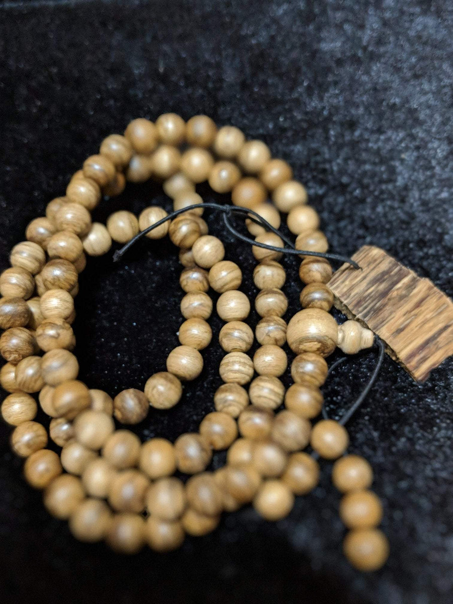 Wild Agarwood mala 108 Malinau 18g 8mm with a large piece of remaining material