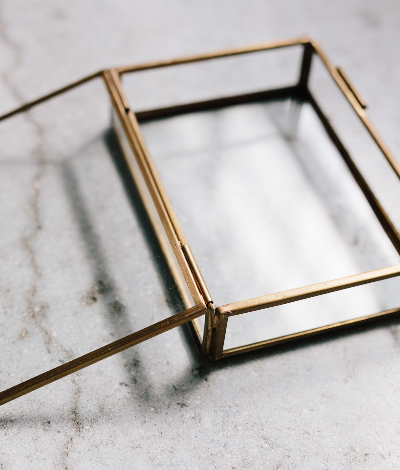 inside view of glass and brass photo box