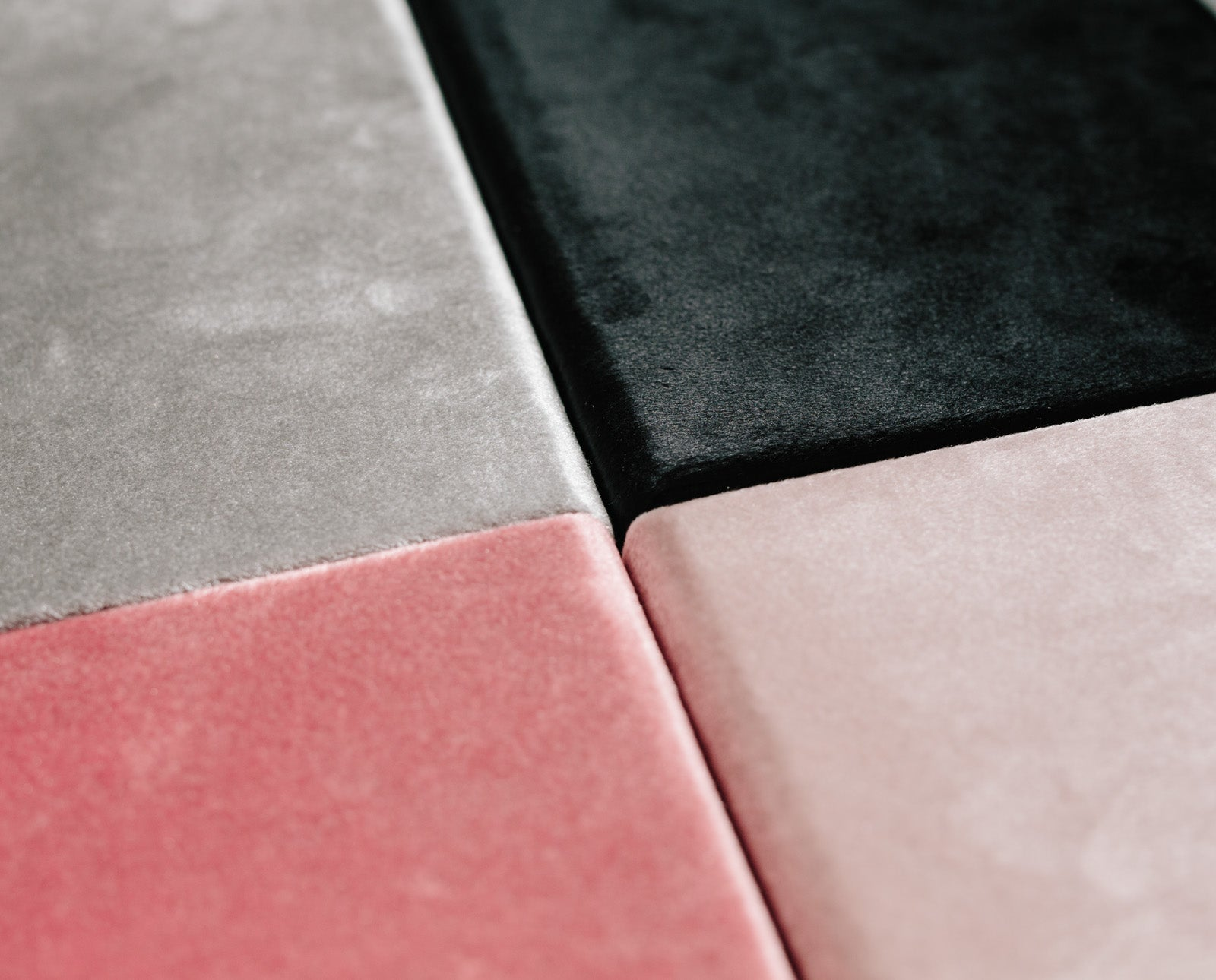 velvet boxes pink grey black closeup of fabric