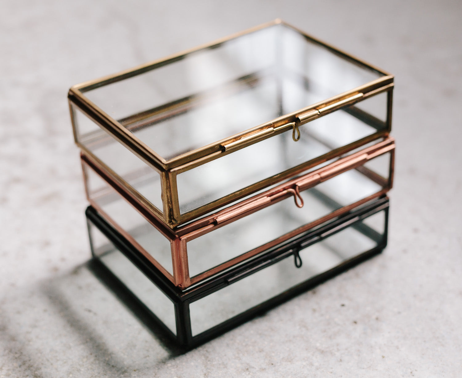 gold and black glass print boxes