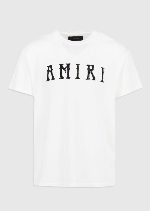 /products/amiri-hippie-tee-y0m03434cj-ivory