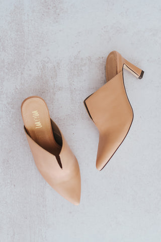 Women's blush colored kitten heel mules.