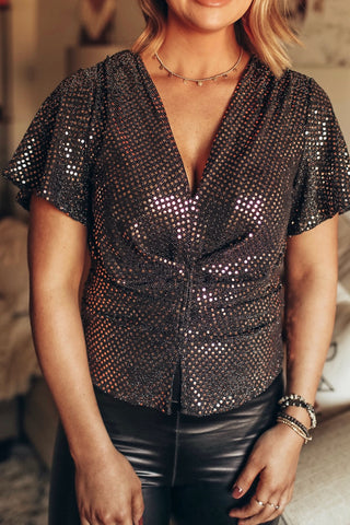 Women's short sleeve black and gold sequin top.