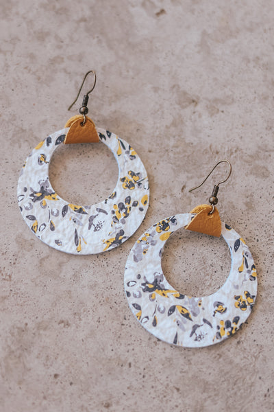 Made in the USA. Handmade floral print leather earrings.