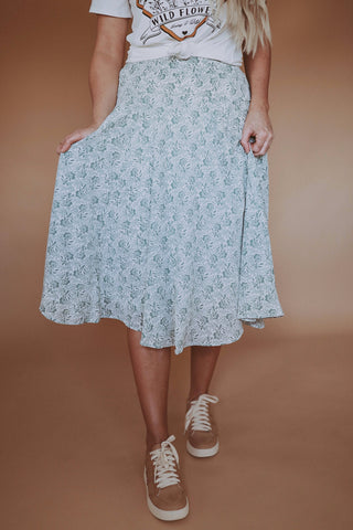 Women's pleated floral print midi skirt.