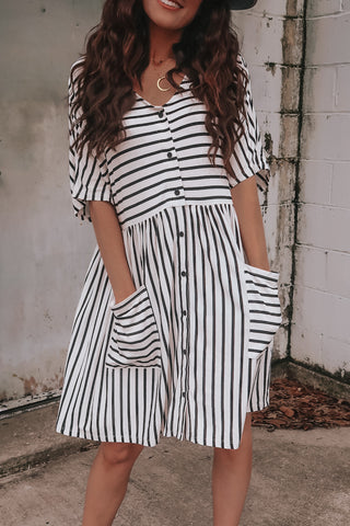 Short sleeve black and white striped dress.
