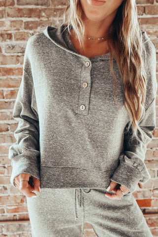 Women's grey button down hoodie.