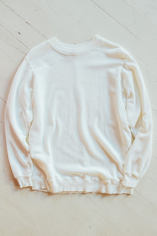 Cream crewneck sweatshirt.