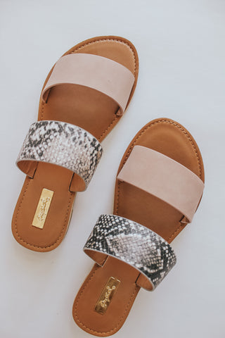 Neutral + snake double strap slides.