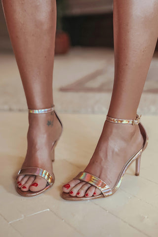 Single band gold stiletto high heel shoes.