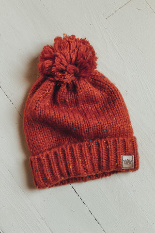 Fleece lined pom pom beanie.