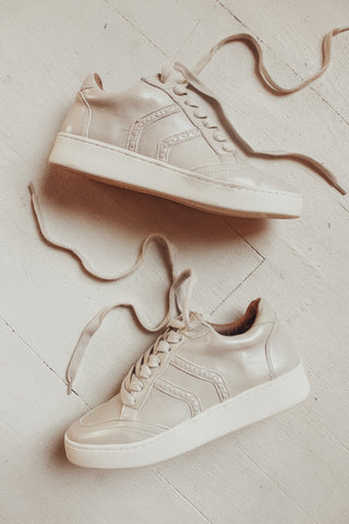 Nude colored sneakers.