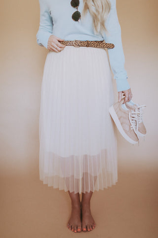 Cream colored sheer pleated skirt.