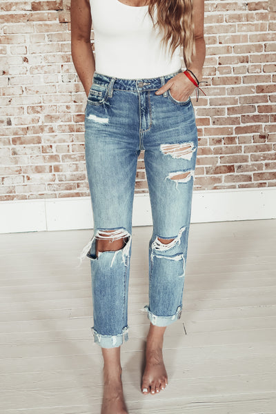 Women's distressed high rise jeans.