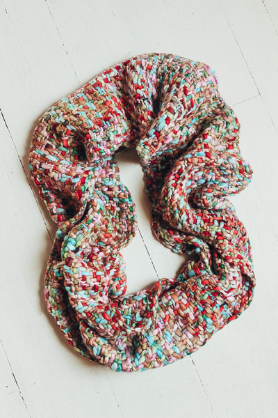 Colorful loom woven infinity scarf.