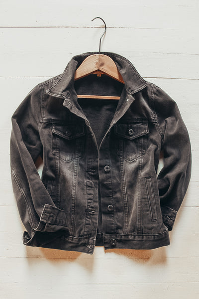Women's black denim jacket.
