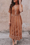 Boho style embroidered dress in light brown.
