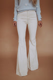 Cream colored super flare denim jeans