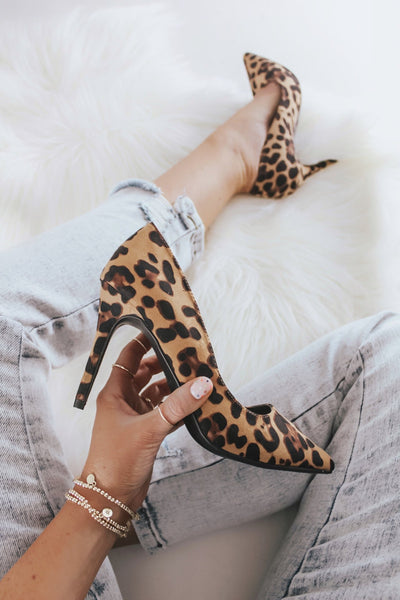 Leopard high heel pumps.