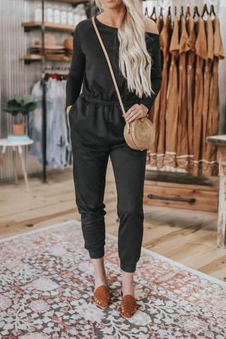 Off The shoulder solid black jumpsuit.