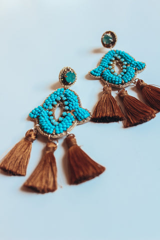 Turquoise seed bead earrings.