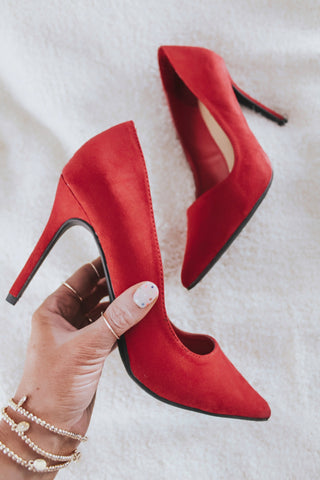Red high heeled pumps.