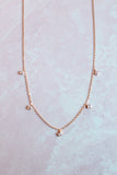 dainty stone necklace.