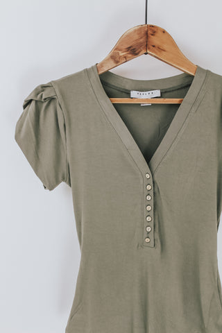 Olive green short sleeve bodysuit.