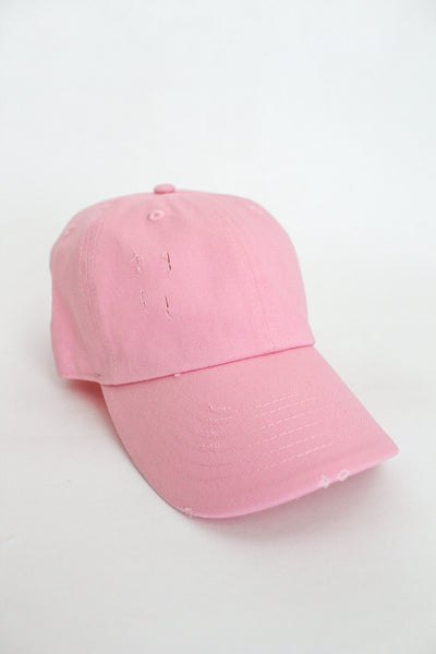 Distressed bubble gum pink ball cap.