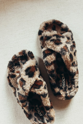 Leopard fur slippers.