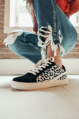 Black and leopard sneakers.