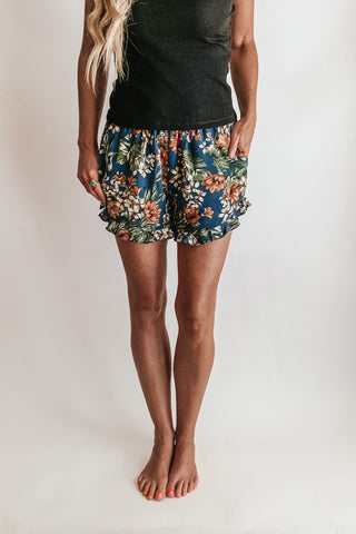 Tropical print floral shorts.