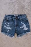 Women's medium wash distressed denim cut off jean shorts.