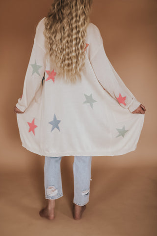 Women's lightweight open front cardigan with multi colored stars.