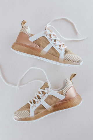 Low top taupe colored lace up sneakers for women.
