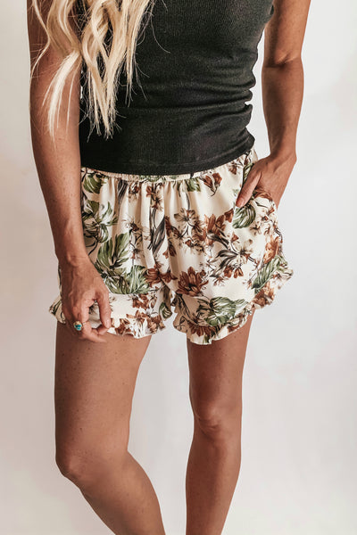 Tropical floral print shorts.