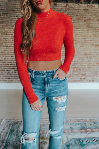 Red cropped long sleeve sweater.