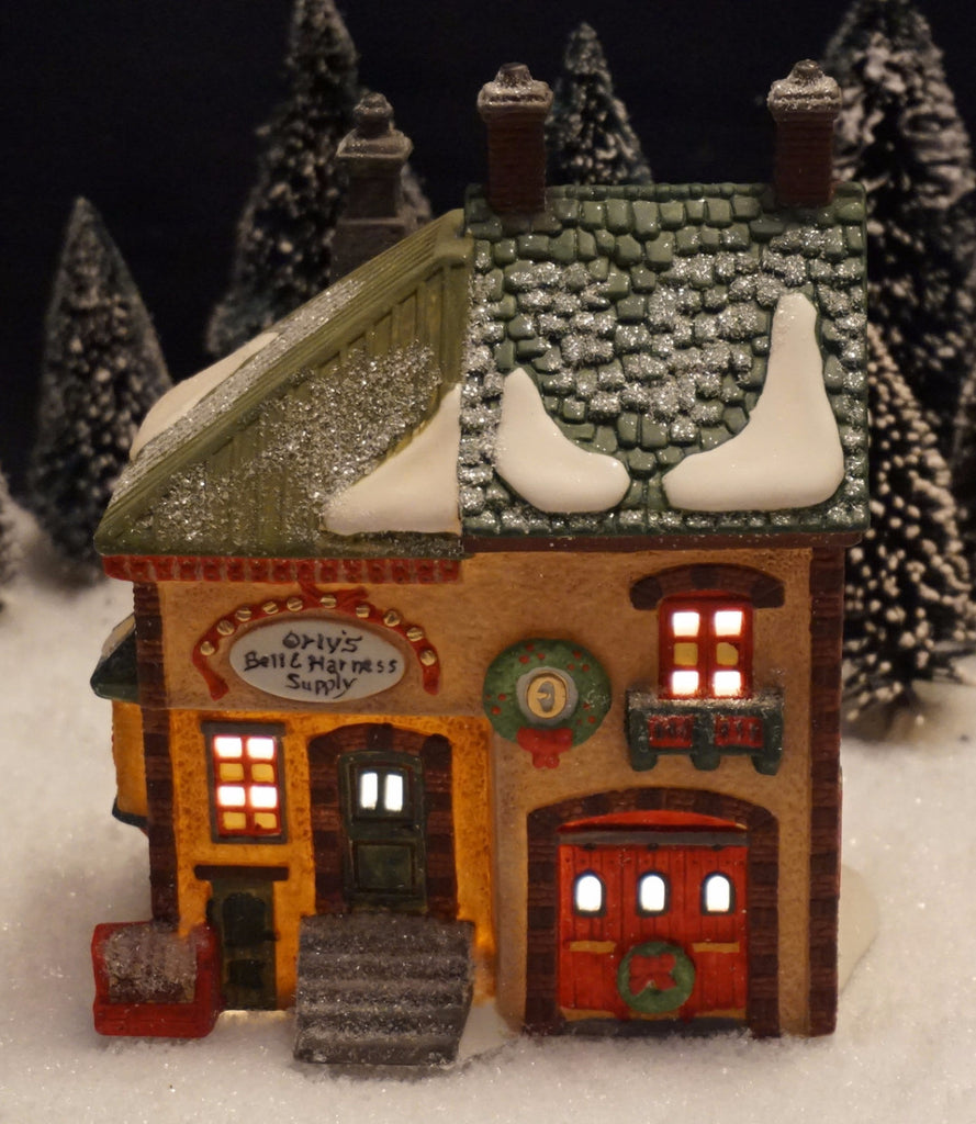 Department 56 North Pole Series - Orley's Bell & Harness Supply. Item number 56219.