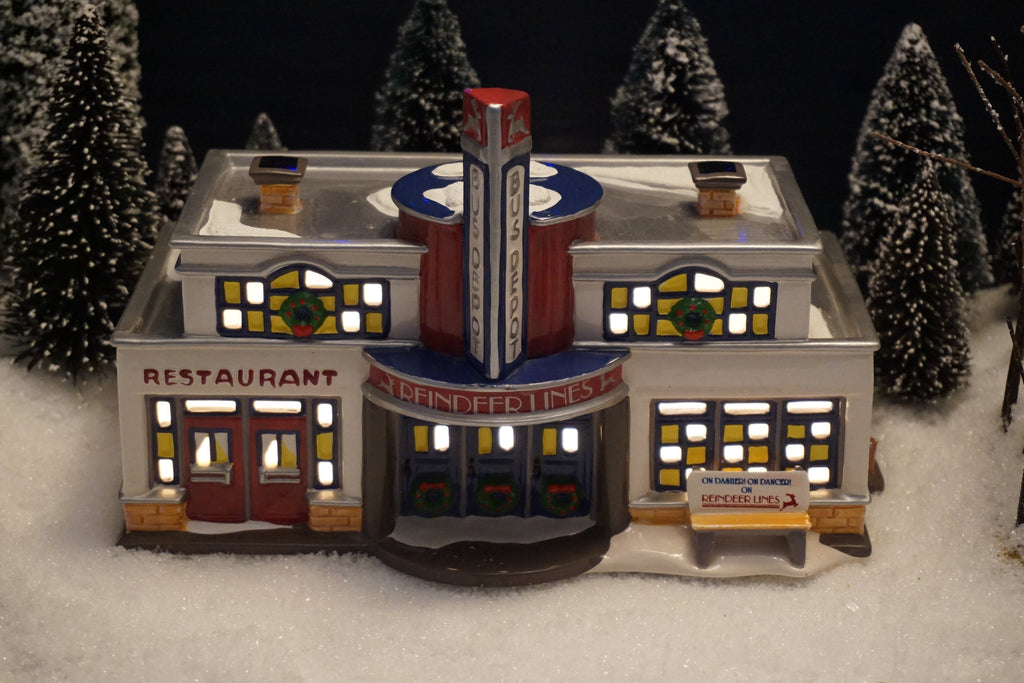Department 56 Snow Village Series - Reindeer Bus Depot. Item number 54874.