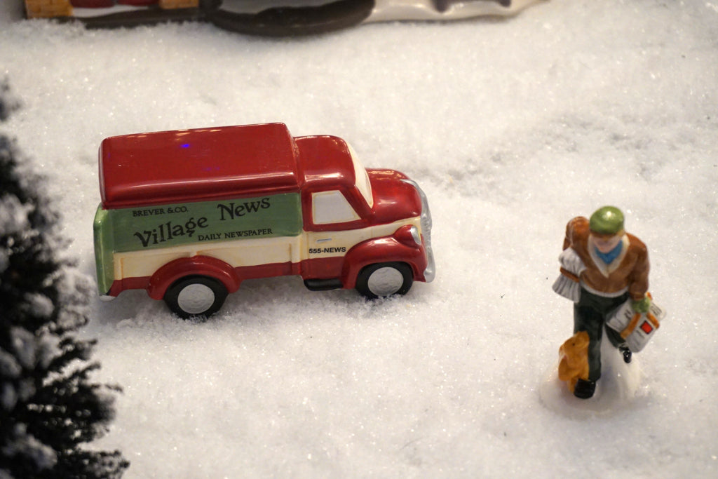 Department 56 Snow Village Series - Village News Delivery. Item number 54593.