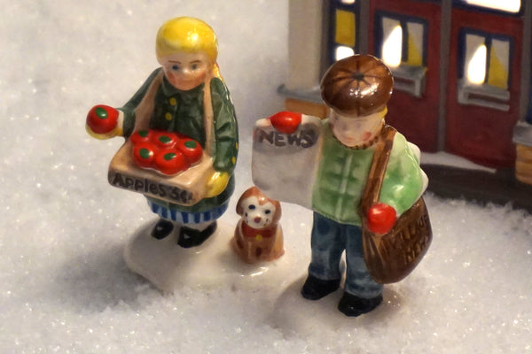 Department 56 Snow Village Series - Girl Selling Apples and News Boy. Item number 51292.