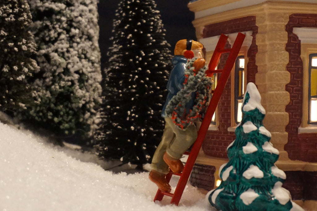 Department 56 Snow Village Series - Man On Ladder Hanging Garland. Item number 51160.