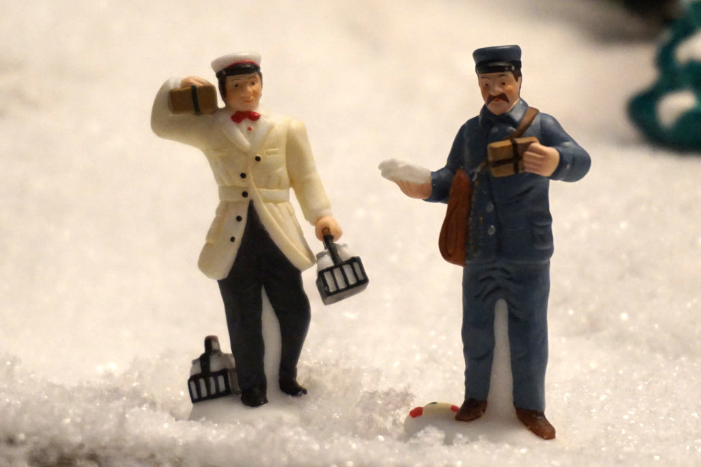 Department 56 Christmas in the City Series - City Professionals - Postman and Dairy Delivery Man. Item number 58965.