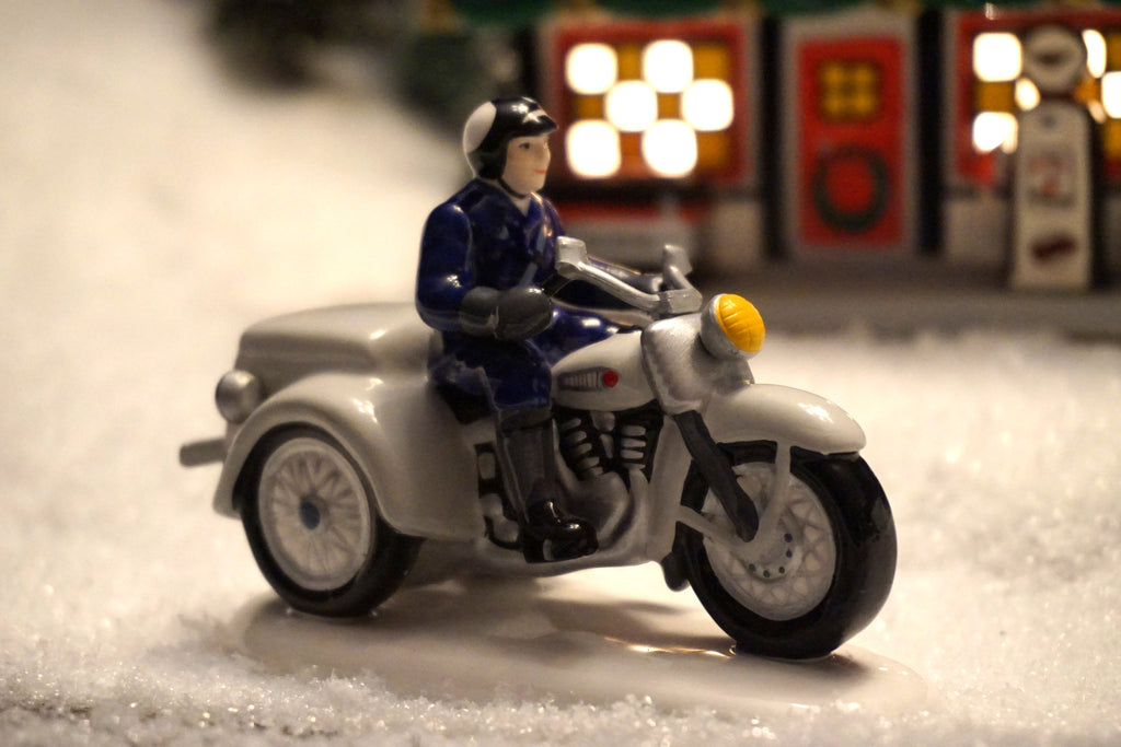 Department 56 Snow Village Series - Patrolling the Road. Item number 54971.