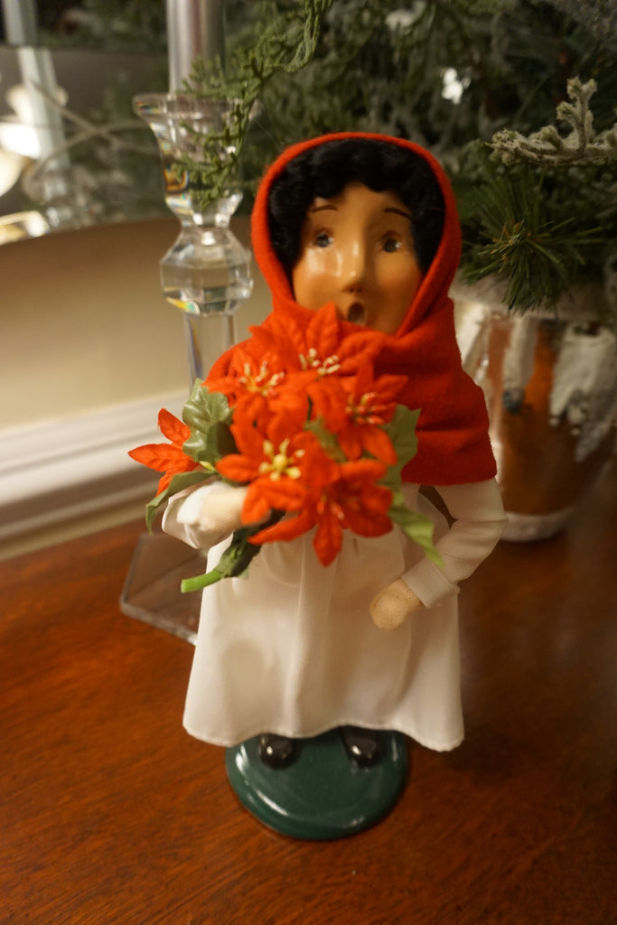 Byers' Choice Caroloer - girl with poinsettia flowers.